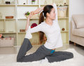 Chinese woman doing yoga at home Stock Photography