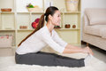 Chinese woman doing yoga at home Royalty Free Stock Photography