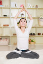 Chinese woman doing yoga at home Royalty Free Stock Photo