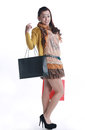 Chinese woman happy shopping holding a bags expression happiness Stock Photography
