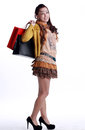 Chinese woman happy shopping holding a bags expression happiness Royalty Free Stock Photos