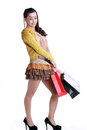 Chinese woman happy shopping holding a bags expression happiness Royalty Free Stock Image