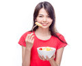 Chinese woman holding bowl of fruit Royalty Free Stock Photo