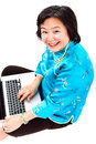 Chinese Woman with laptop smiling, upper view Stock Photos