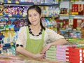 Chinese woman seller in shop young at food supermarket china Royalty Free Stock Photos
