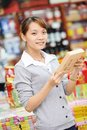 Chinese woman shopping food young choosing tea during at china supermarket Stock Photography