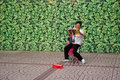 Chinese woman singing in hong kong aug a is along the street to earn money on august Royalty Free Stock Photos
