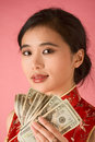 Chinese woman with US money 20 dollar bill Royalty Free Stock Photography