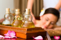 Chinese woman at wellness massage with essential oils asian in beauty spa having aroma therapy oil looking relaxed Stock Photography
