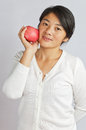 Chinese women take the apple oriental woman Royalty Free Stock Photography
