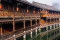 Chinese wood structure building by water an old fashioned at the riverside in chengdu china Stock Photo