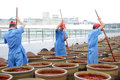 Chinese worker making Pixian Horsebean Chili Paste Royalty Free Stock Photo