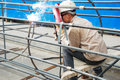 Chinese worker welding steel