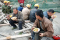 Chinese workers have lunch on the construction site located in chengdu china Stock Photography