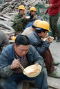 Chinese workers have lunch on the construction site located in chengdu china Stock Photo