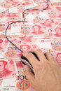 Chinese Yuan and Computer Mouse Royalty Free Stock Image