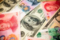 Chinese Yuan Note and U.S. dollar background