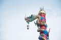 Chiness dragon pole with blue sky Stock Photos