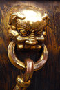 Chinesse door a golden lion in forbidden city in beijing Royalty Free Stock Photo