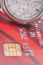 Chip of Credit cards and a watch up close Royalty Free Stock Photo