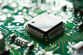 Chip on green circuit board selective focus Stock Photography
