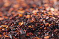 Chipotle jalapeno smoked chili flakes background shallow dof Stock Images