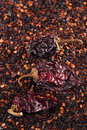 Chipotle jalapeno smoked chili flakes and whole background shallow dof Stock Photo