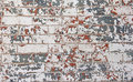 Chipped red white blue paint brick wall Royalty Free Stock Photo
