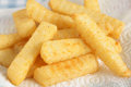 Chips freshly cooked crinkle cut or french fries Royalty Free Stock Photo