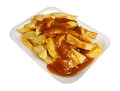 Chips and gravy french fries or a popular european takeaway snack served in a polystyrene tray from a take out Royalty Free Stock Photos