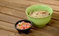 Chips and pico de gallo on a picnic table Royalty Free Stock Photography