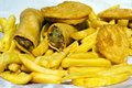 Chips potato fritters and spring rolls fast food takeaway meal dish outdoor Stock Photos