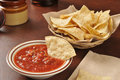 Chips and salsa corn tortilla with a bottle of beer in the background Stock Photos
