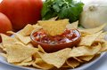 Chips and salsa a plate of with onion cilantro tomatoes Stock Photos