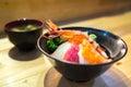 Chirashi sushi, Japanese food, rice bowl with raw salmon sashimi, scallop, shrimp, surf clam, salmon eggs, octopus, tuna, hamachi, Royalty Free Stock Photo