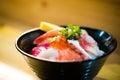 Chirashi sushi, Japanese food, rice bowl with raw salmon sashimi, scallop, shrimp, surf clam, salmon eggs, octopus, tuna, and swee Royalty Free Stock Photo