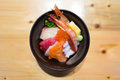 Chirashi sushi, Japanese food rice bowl with raw salmon sashimi, tuna, and other mixed seafood, top view, center aligned with copy Royalty Free Stock Photo