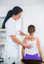 Chiropractor doing adjustment on female patient in doctor s office Royalty Free Stock Image