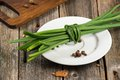 Chive on a plate at old wood Royalty Free Stock Photo