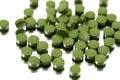 Chlorella algae pills on the white background Royalty Free Stock Images