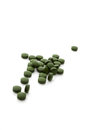Chlorella pills pile on white background green dietary supplement concept Stock Photography