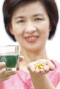 Chlorophyll drink and cod liver oil for middle aged health woman Stock Photo