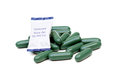 Chlorophyll tablets with desiccant pack isolated using silica gel with medicine to prevent humidity Royalty Free Stock Photo