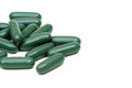 Chlorophyll tablets isolated on white background Stock Photo