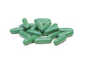 Chlorophyll tablets isolated on white background Royalty Free Stock Photo