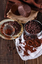 Choc chips and cocoa powder over dark wooden background selective focus shallow dof Stock Photos