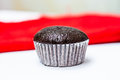 Choccolate babana cup cake with red cloth background Royalty Free Stock Photography