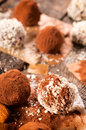 Choco balls sweet chocolate pralinas splashed on the table selective focus on the front praline Royalty Free Stock Photography
