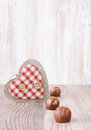 Chocolartes and decorative heart text space row of chocolates on wooden background Stock Image