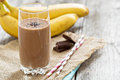 Chocolata banana smoothie in a glass with straws Stock Images